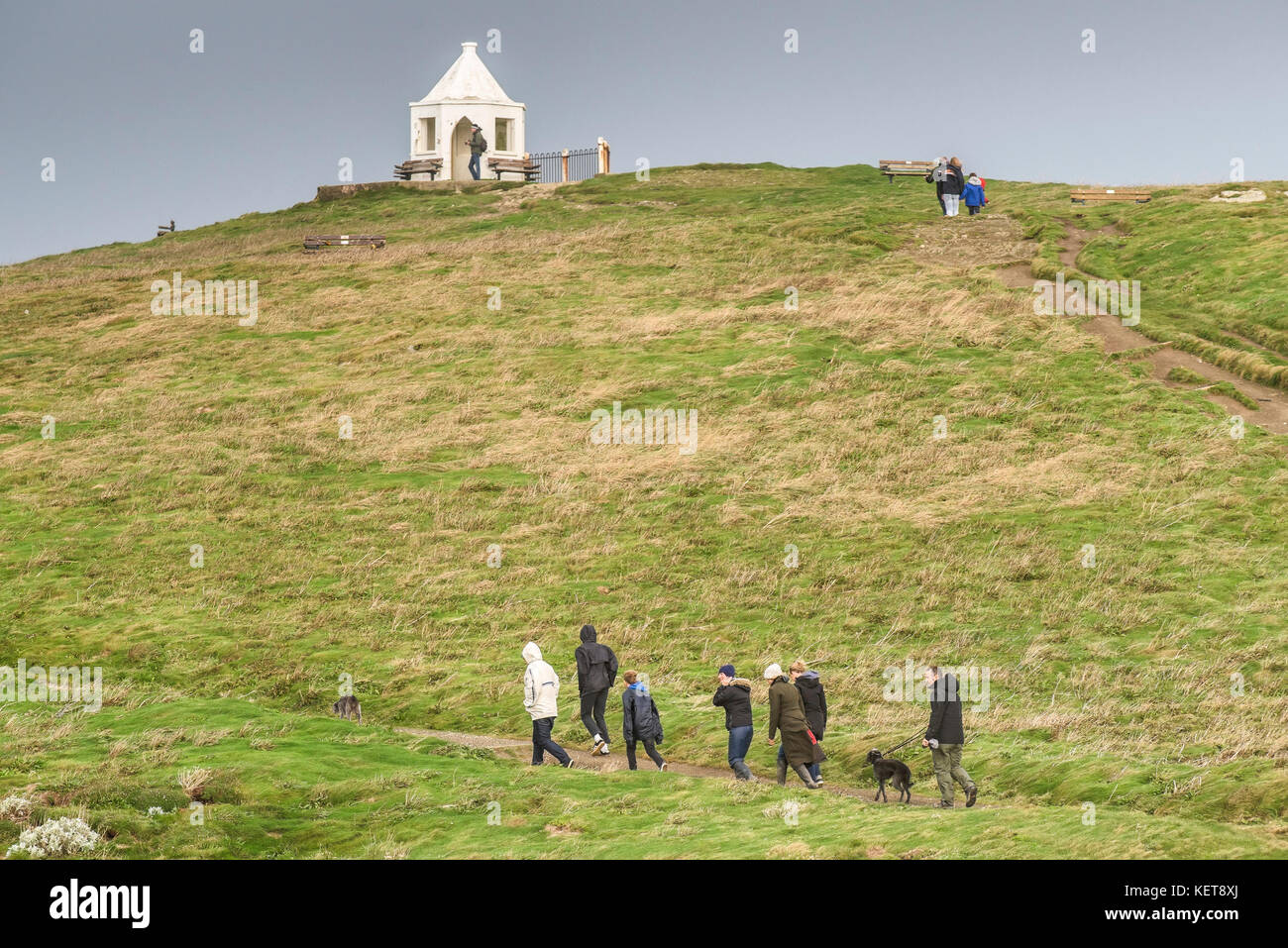 Walking in the countryside - people walking along footpaths on a hillside; - Stock Image