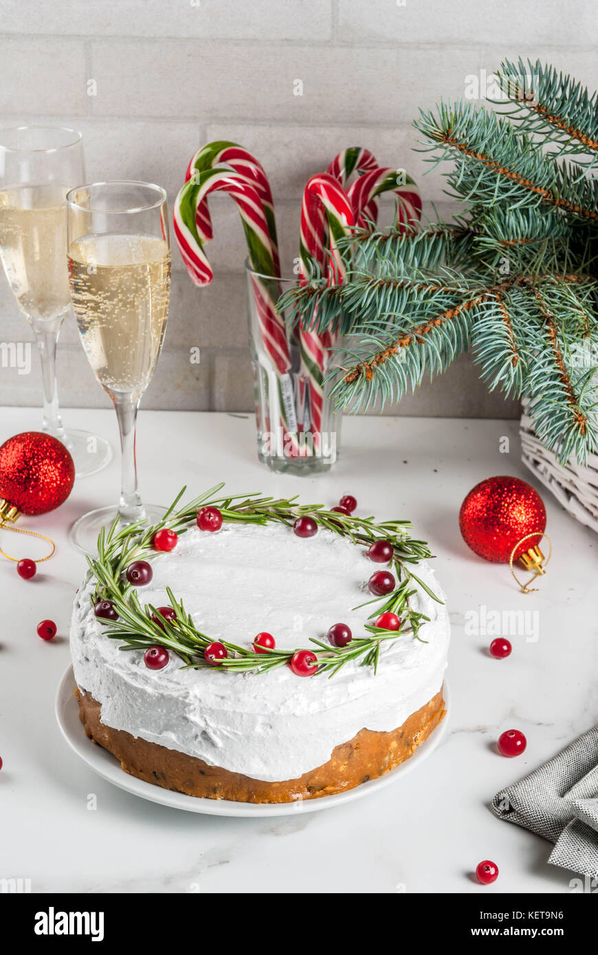 christmas fruit cake or pudding decorated with rosemary and cranberry with christmas decoration - Christmas Fruit Cake Decoration