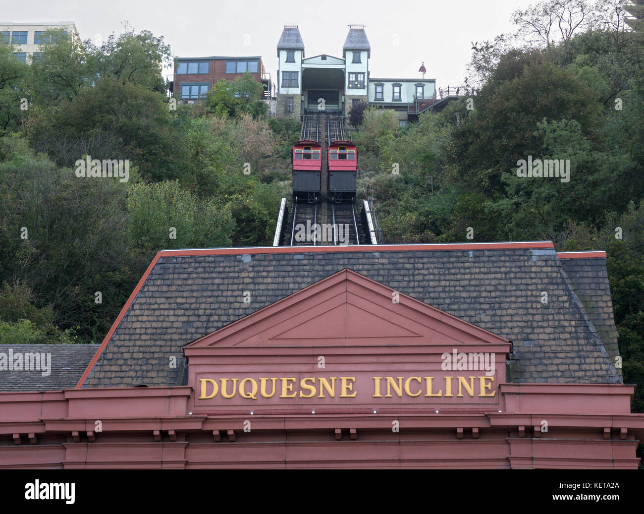 Two wooden cable cars, one ascending the other descending the Duquesne Incline tourist spot in Pittsburgh, Pennsylvania. - Stock Image