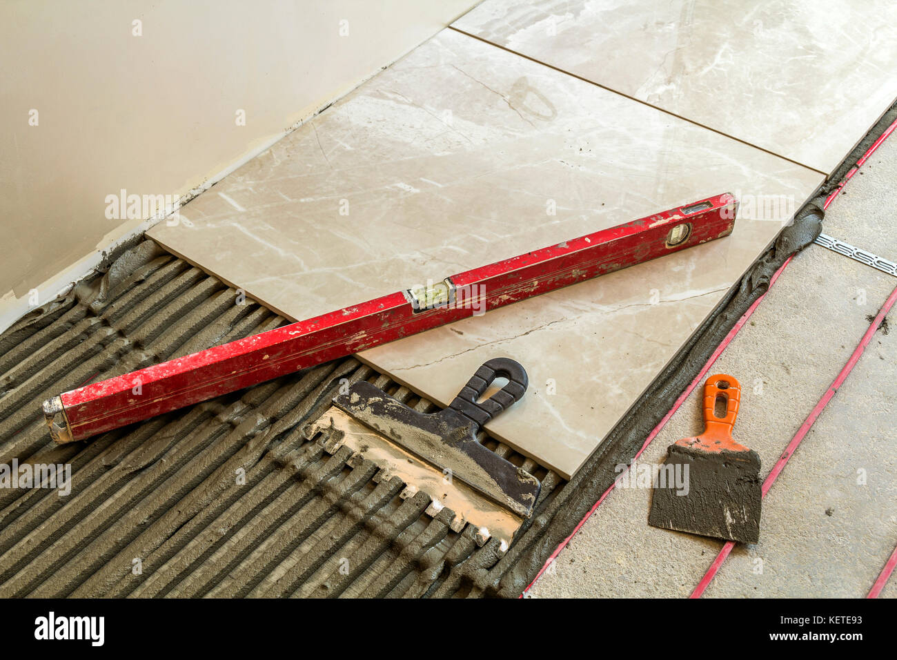 Ceramic tiles and tools for tiler floor tiles installation home ceramic tiles and tools for tiler floor tiles installation home improvement renovation ceramic tile floor adhesive mortar level dailygadgetfo Images