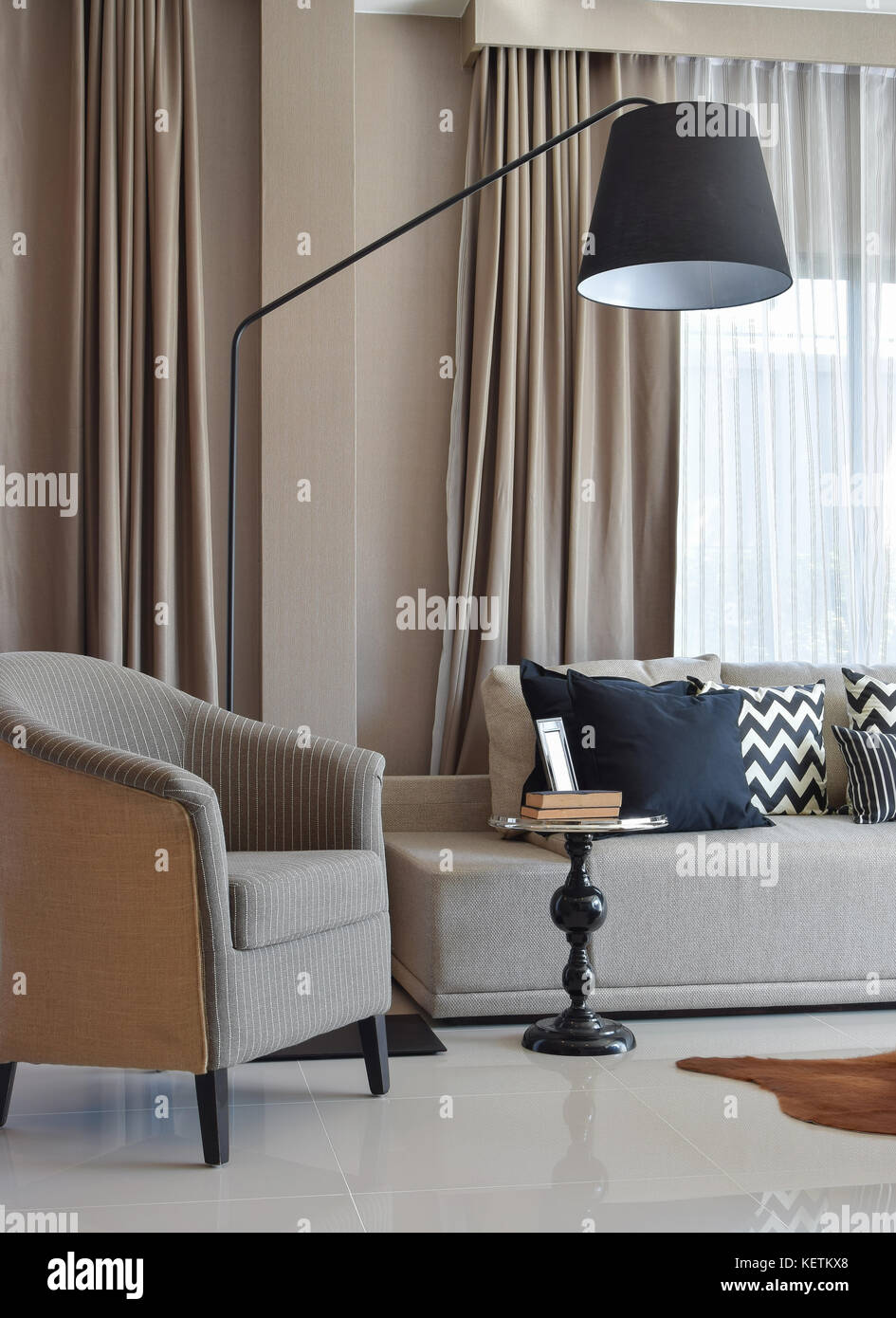 stylish living room design with grey striped pillows on comfortable