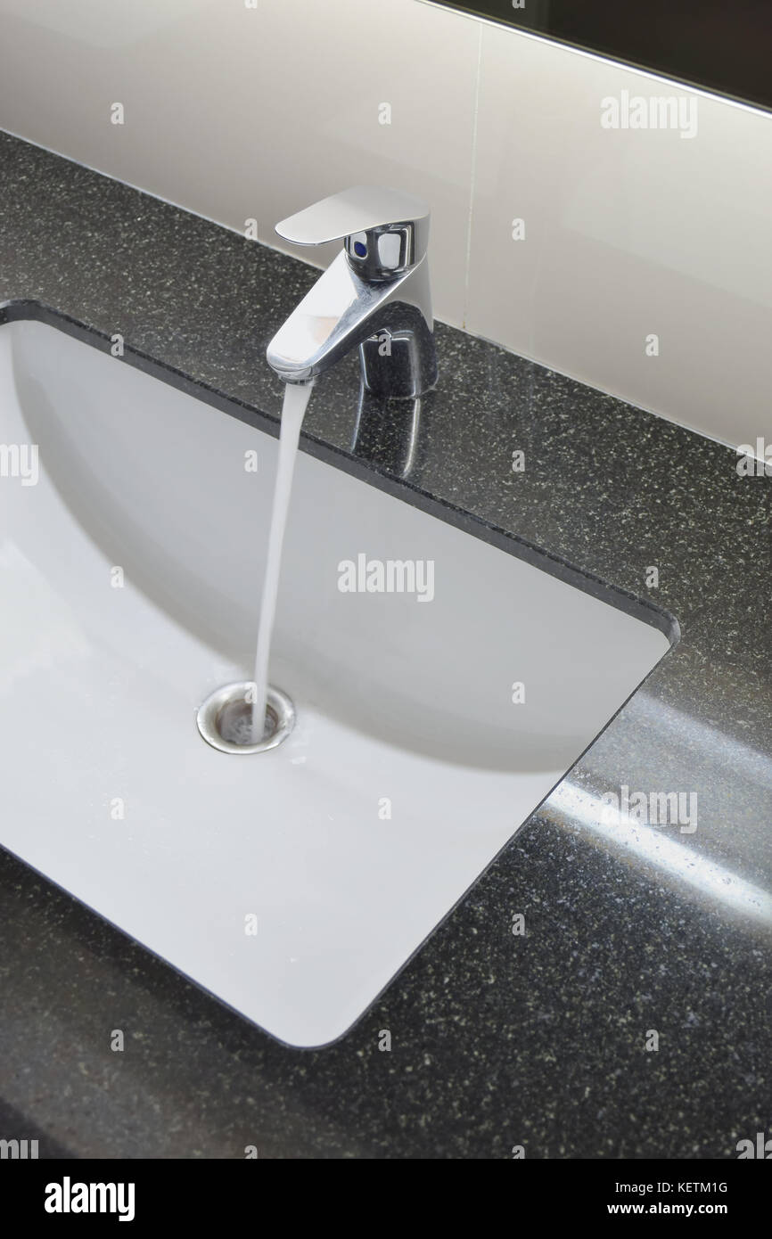 Water Tap And Under Counter Wash Basin With Black Granite Top Stock Photo Alamy