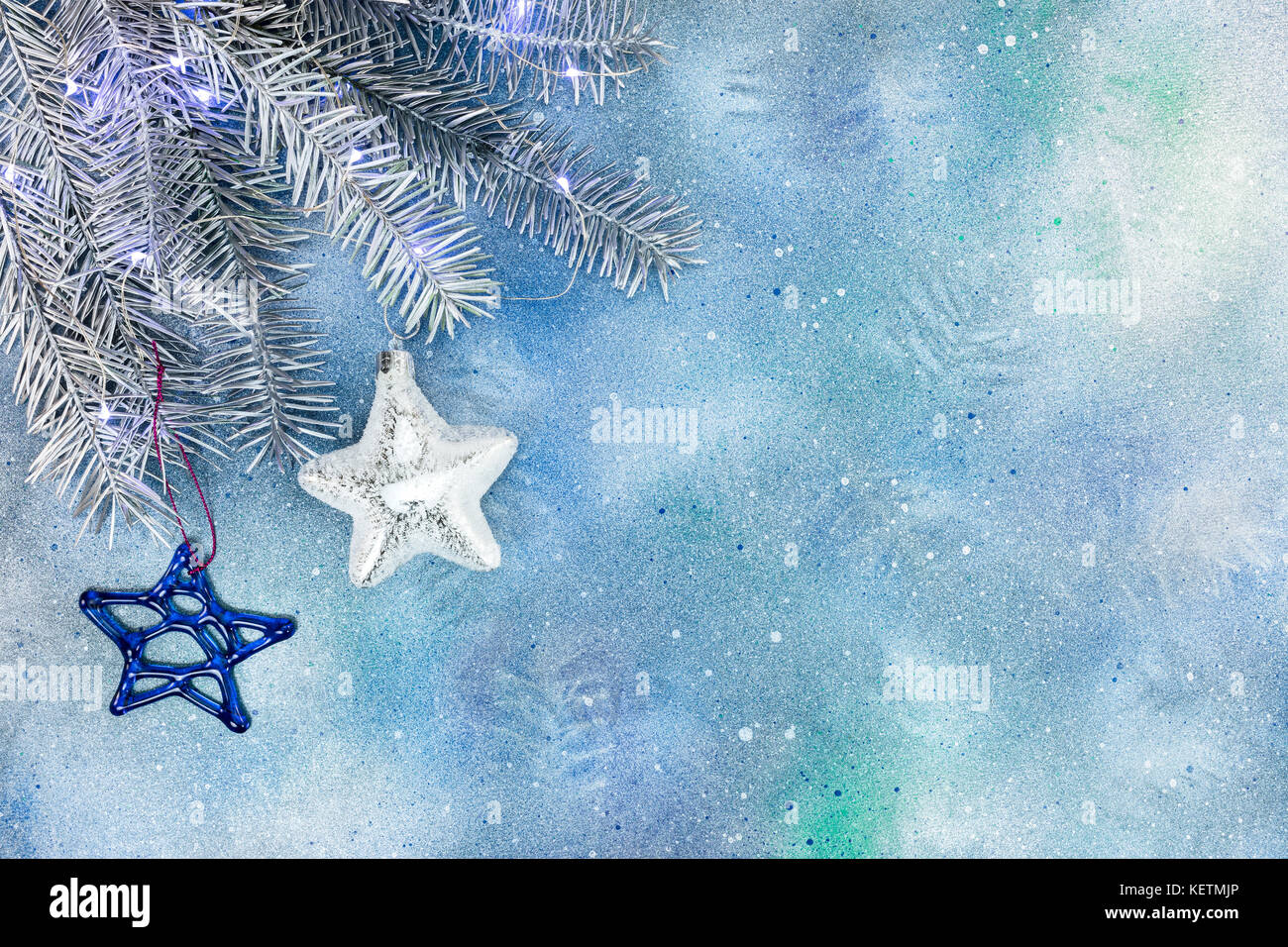 Frozen Christmas Decorations.Silver Christmas Tree Branch With Decorations Of Glass Stars
