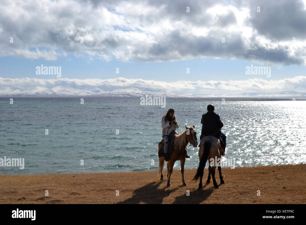 Pictures taken during a 3-day horse riding trek in Kyrgyzstan at Song Kol lake. Mountains, landscapes, Steppe and Stock Photo