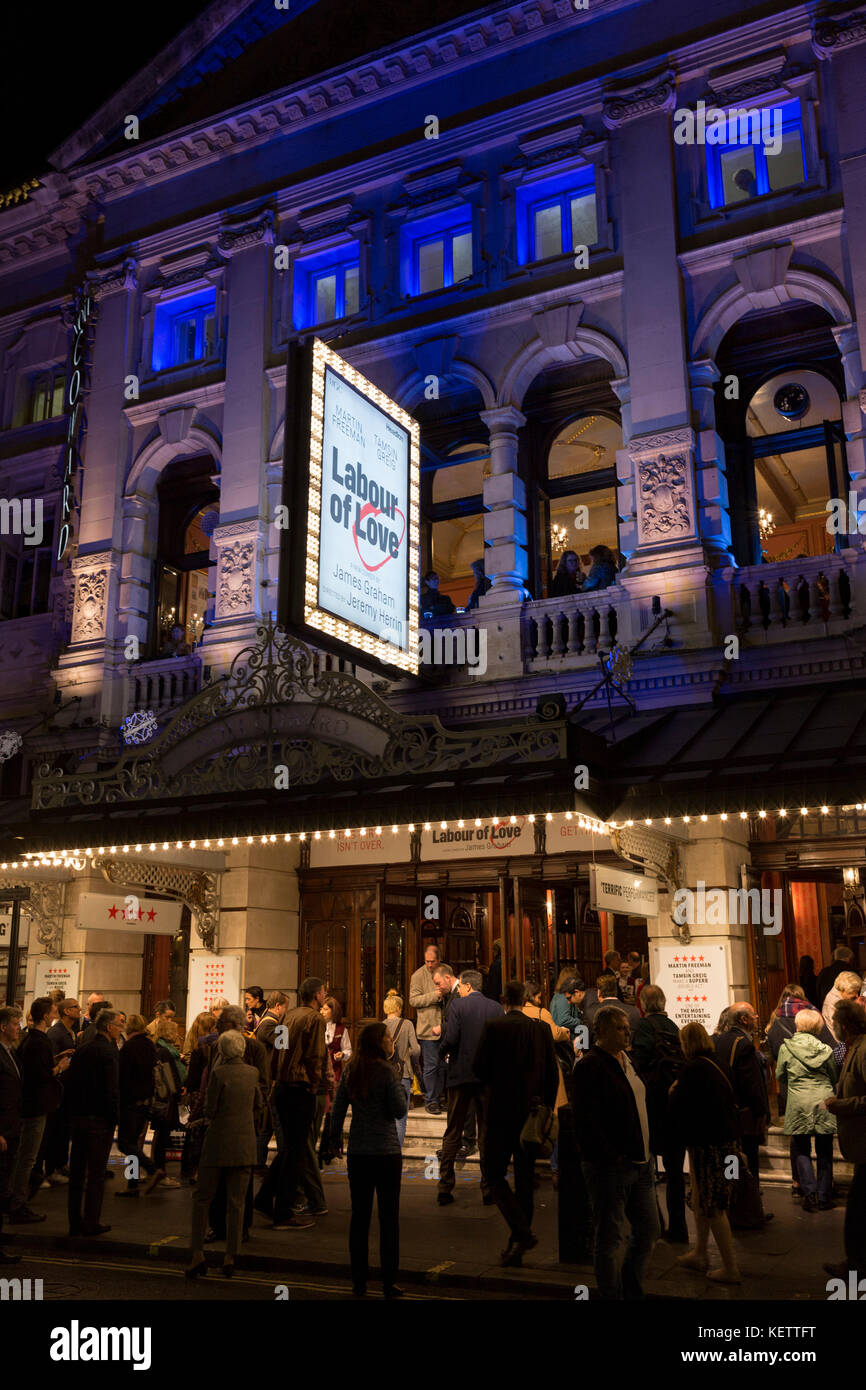 Theatre-goers outside the Noel Coward Theatre in St. Martin's Lane queue to see Labour of Love, a political - Stock Image