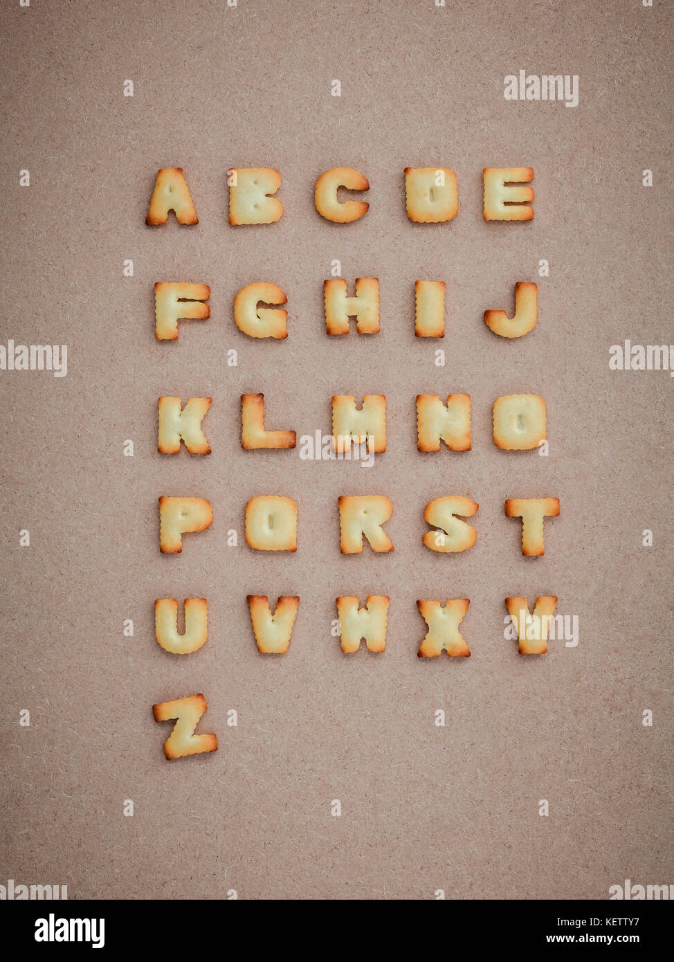 Cookies ABC in the form of alphabet A-Z on brown cardboard background, Valentines day - Stock Image