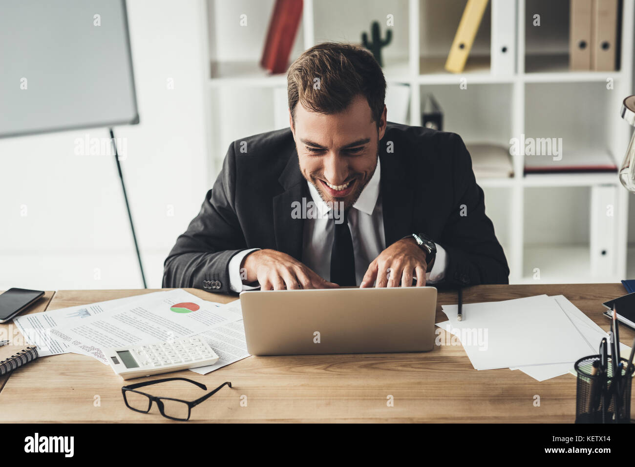 businessman working with laptop - Stock Image