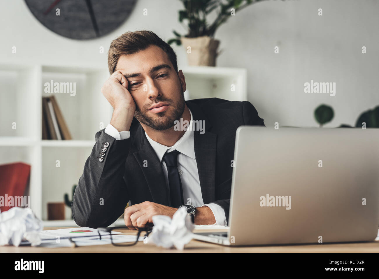 sleeping overworked businessman - Stock Image