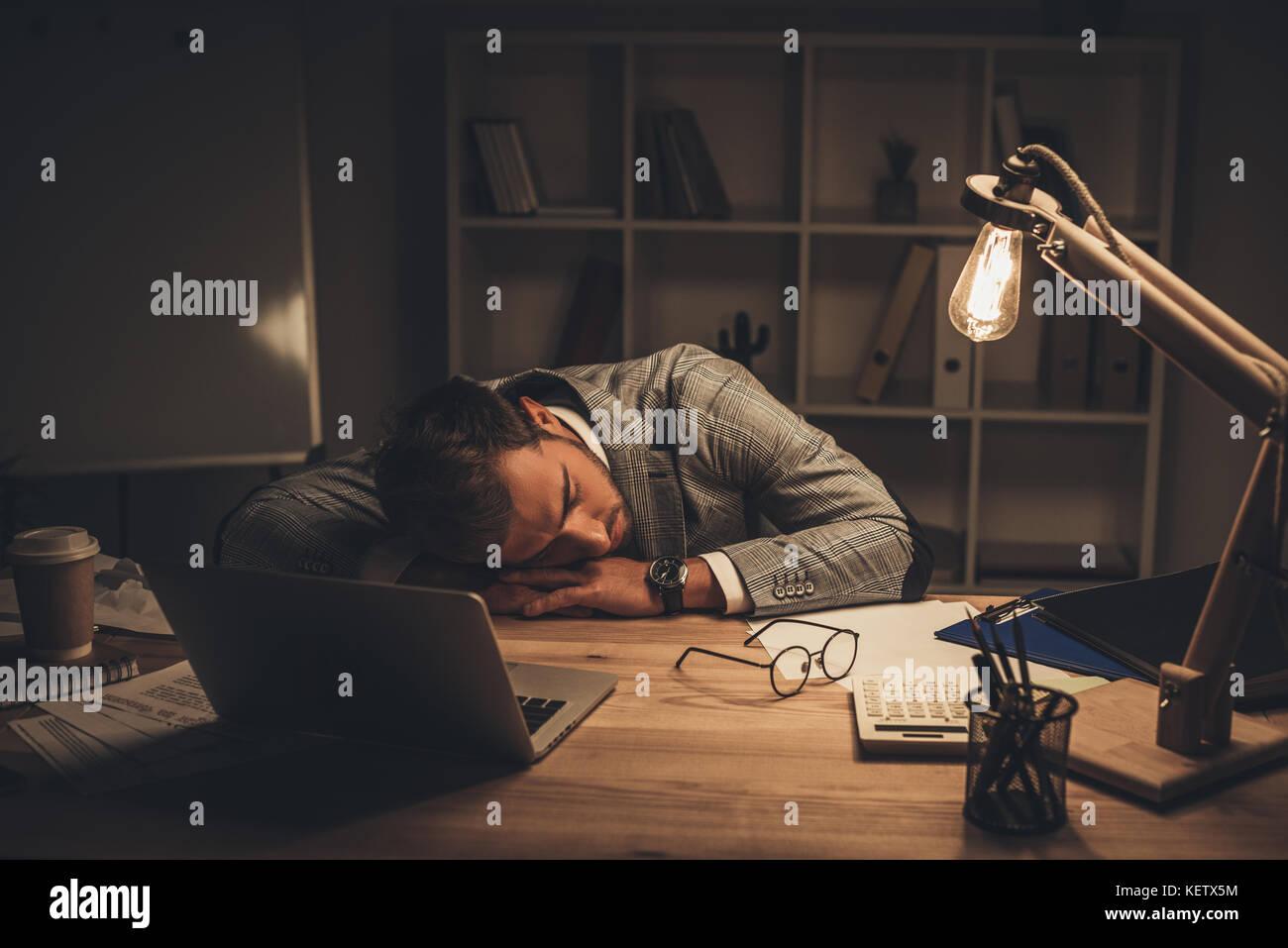 sleeping businessman in office - Stock Image