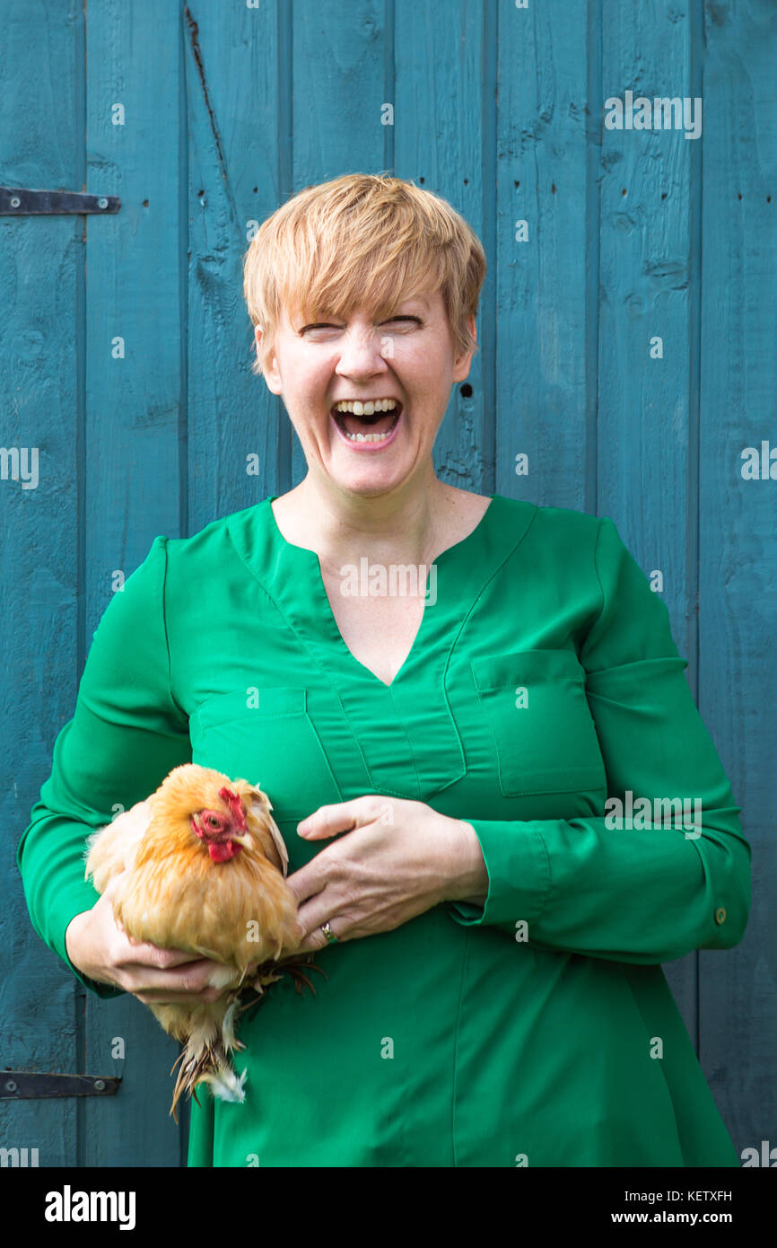 Lady with her bantam chicken pets - Stock Image