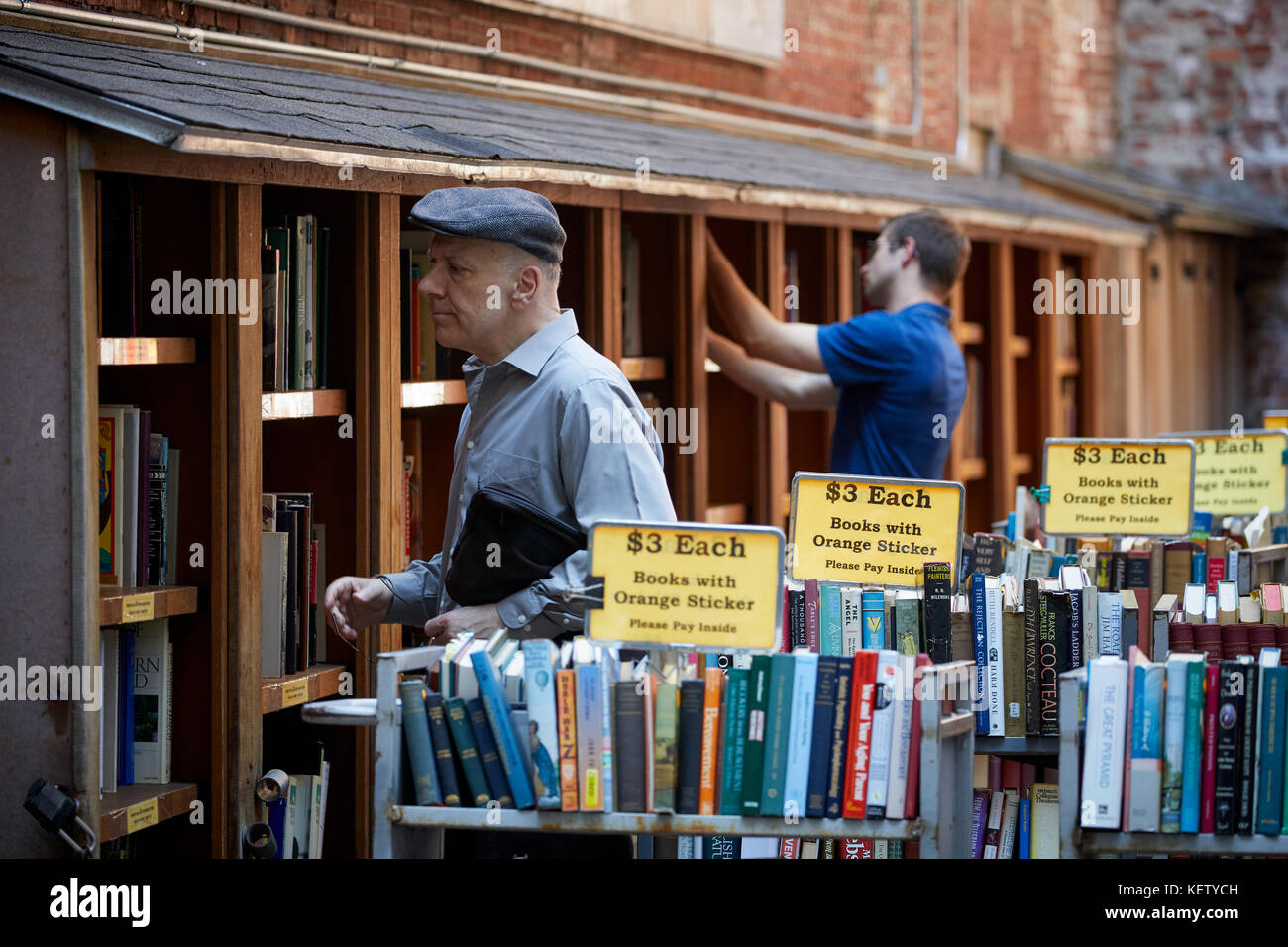 Boston Massachusetts New England North America USA , browsing secondhand books at the oldest and largest used book - Stock Image