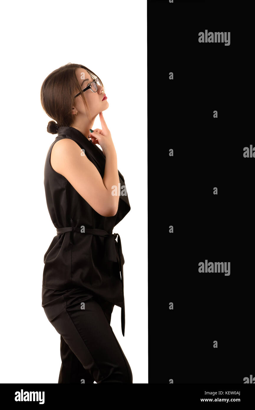 pensive young Korean business woman on black and white background, concept Stock Photo