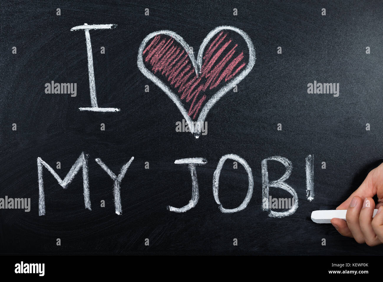A Person Hand Showing Job Loving Concept Written On Blackboard Stock Photo