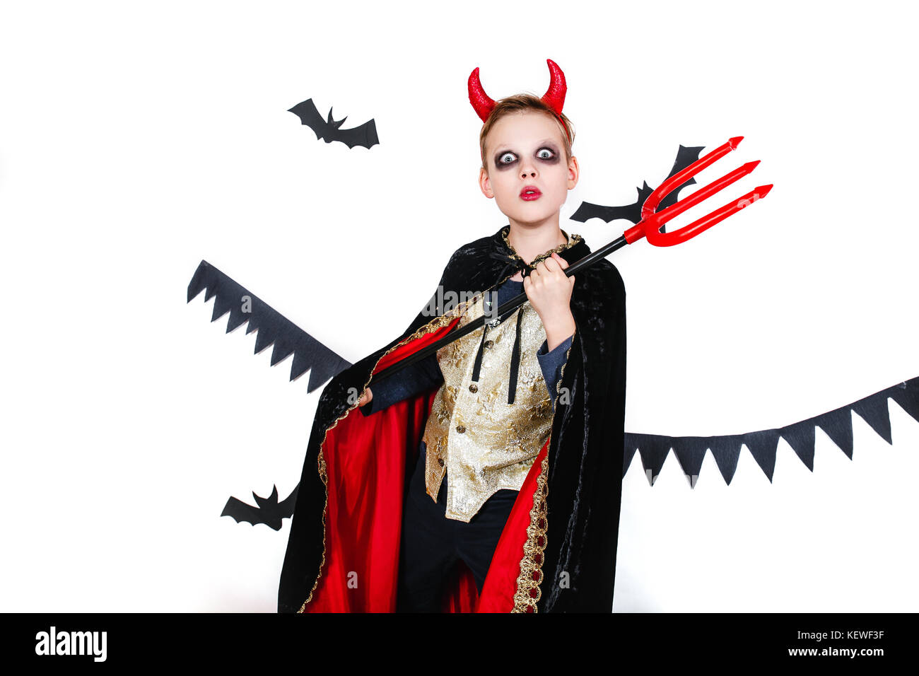 holiday halloween. funny child in carnival costumes devil on a white background - Stock Image  sc 1 st  Alamy & Doll Costumes Stock Photos u0026 Doll Costumes Stock Images - Alamy
