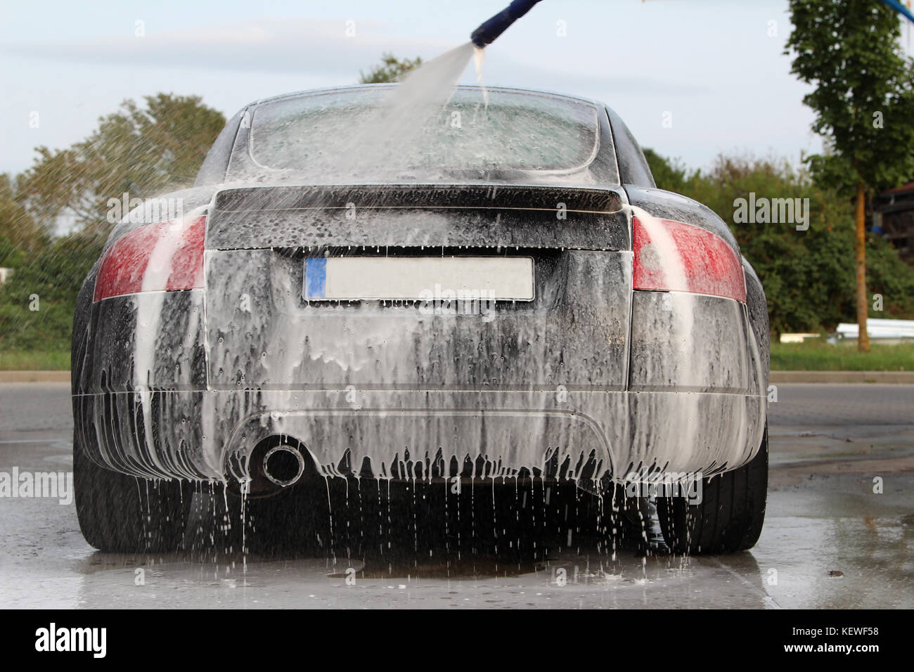 Car detailing : Car Washing with Foam Shampoo. Stock Photo