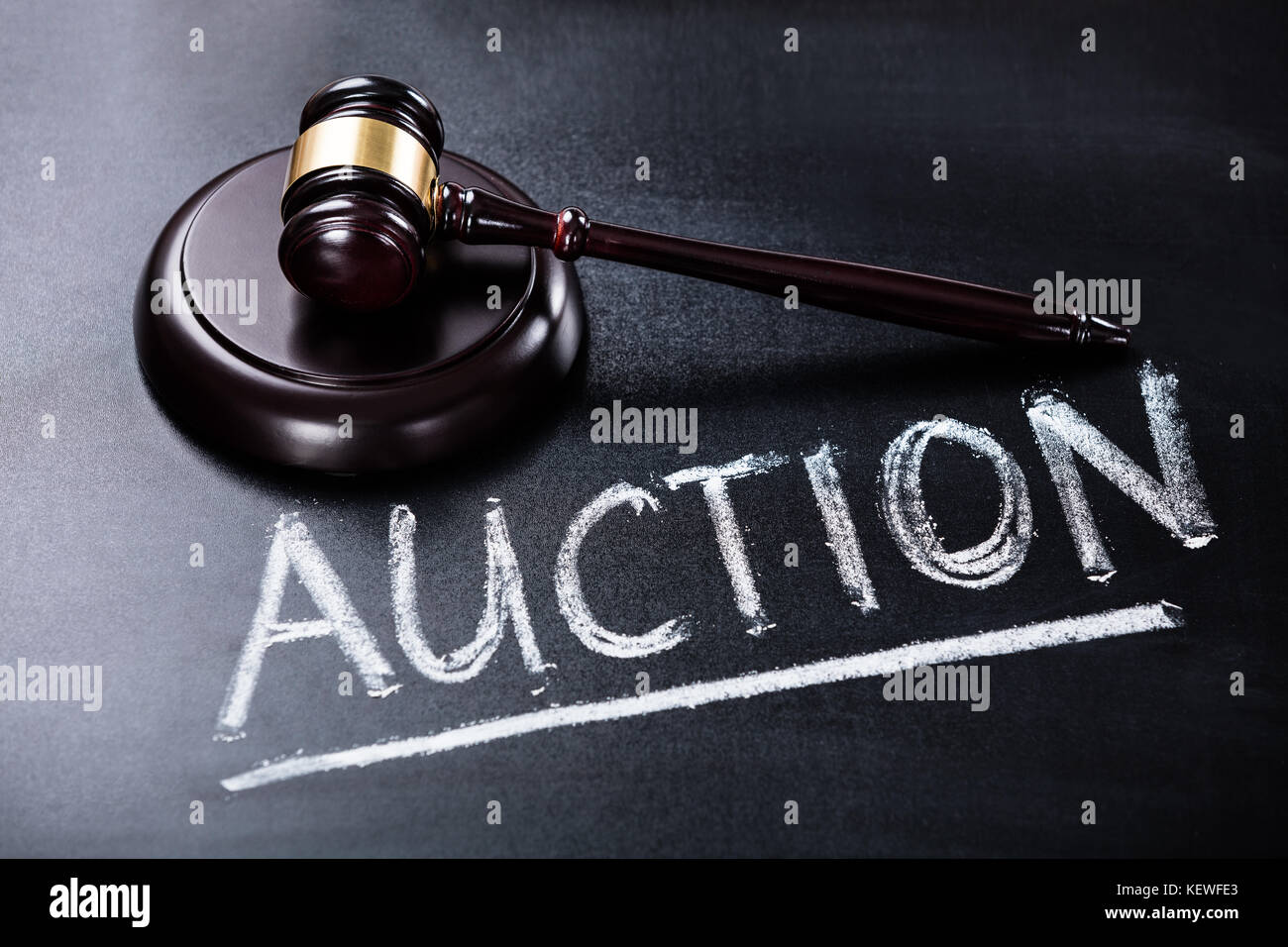 Close-up Of Auction Concept With Brown Gavel On Blackboard - Stock Image