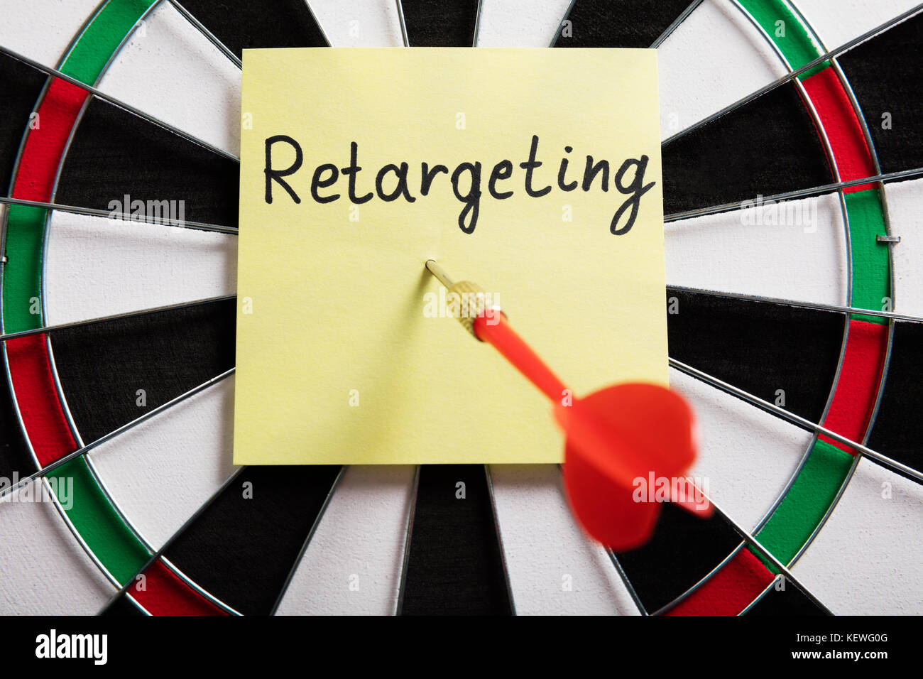 Dart And Arrow With Retargeting Word On Sticky Note - Stock Image