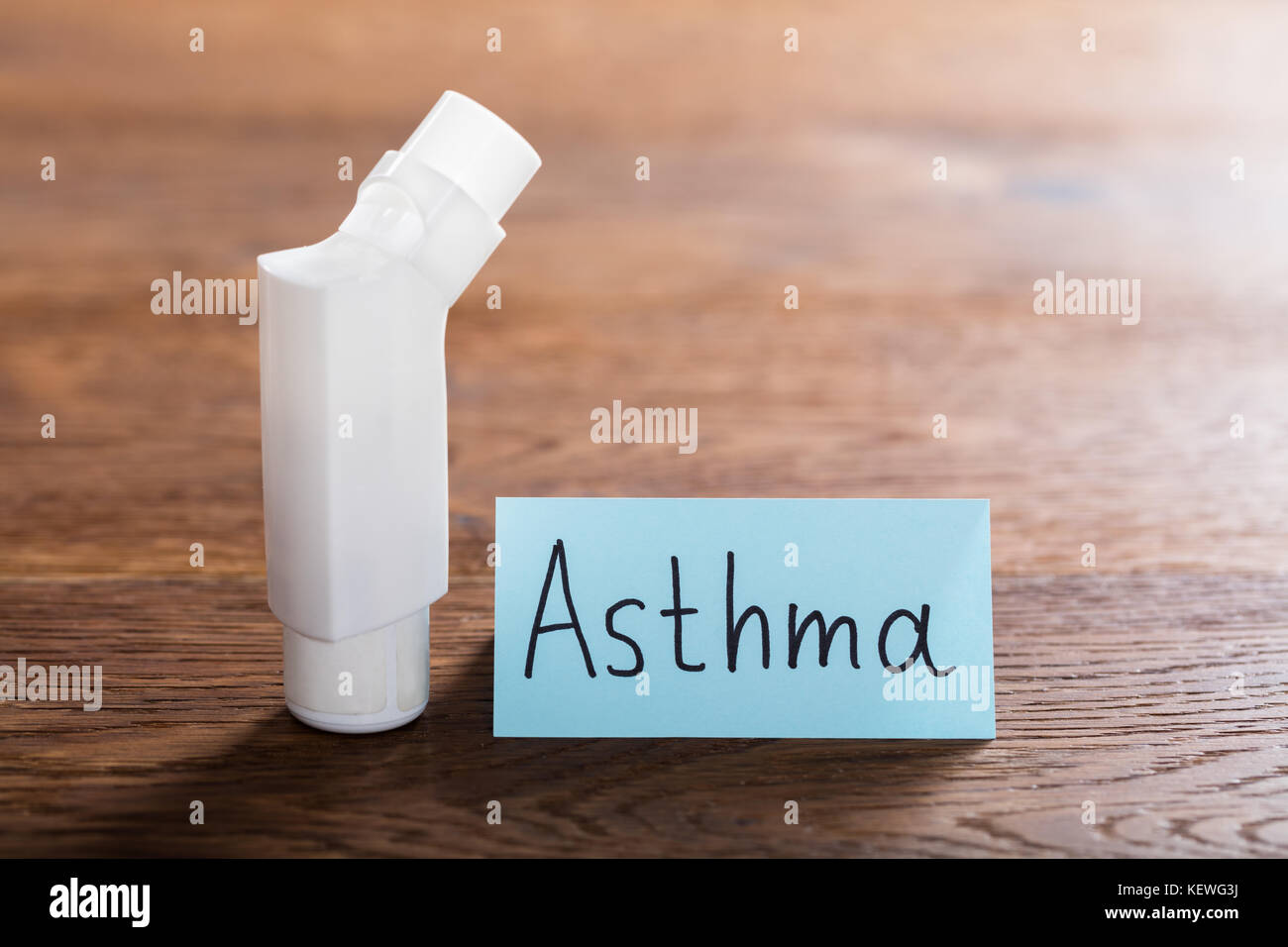 Medical Concept Of Asthma With An Inhaler On Wooden Desk - Stock Image