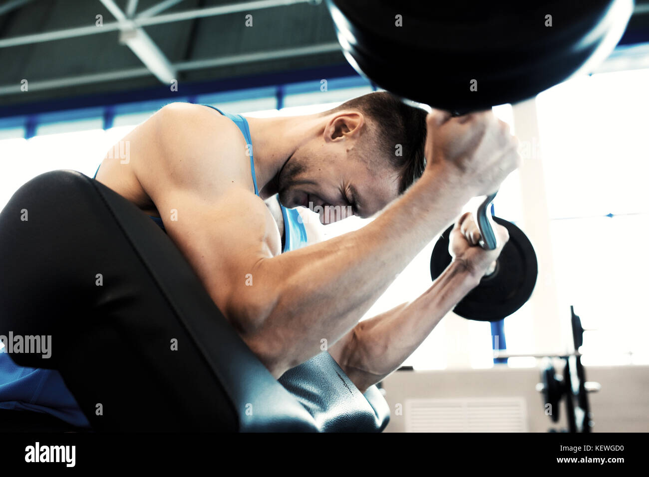 Strong Man Working Out with Barbell - Stock Image