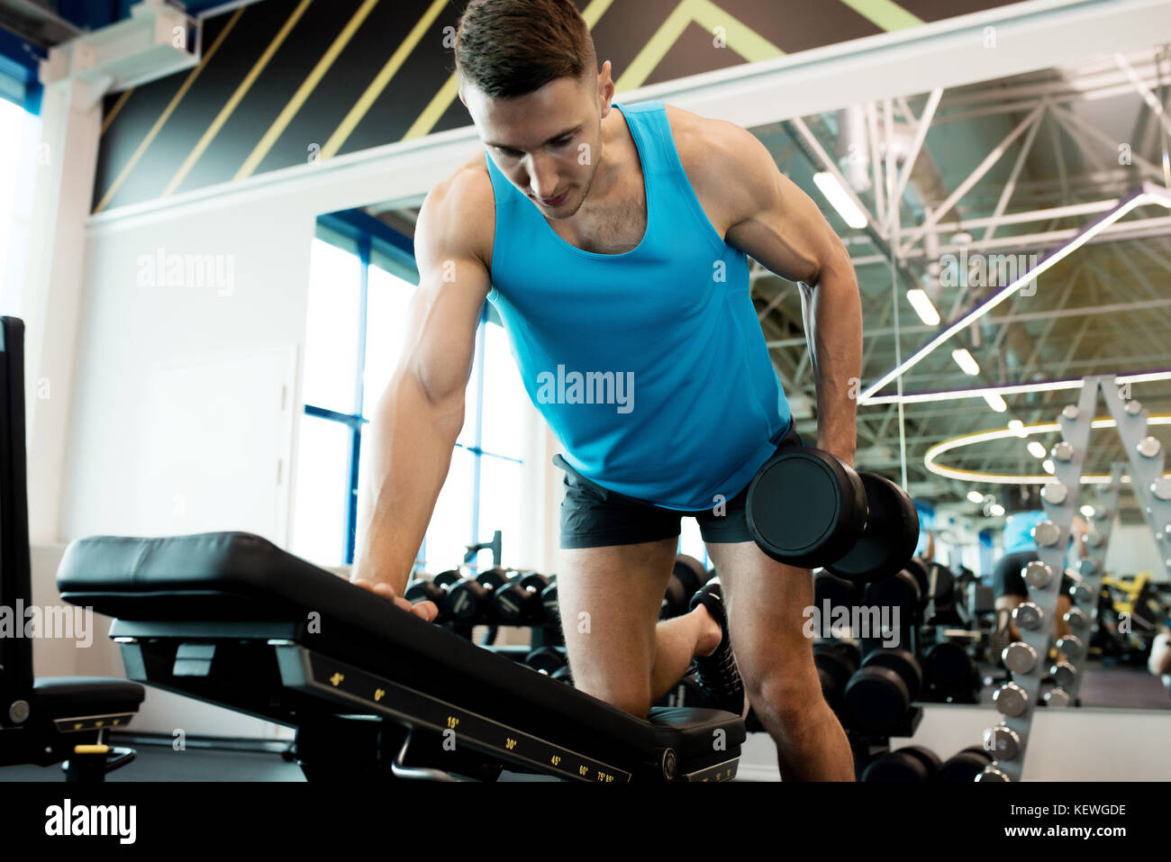 Handsome Man Working Out with Dumbbells - Stock Image
