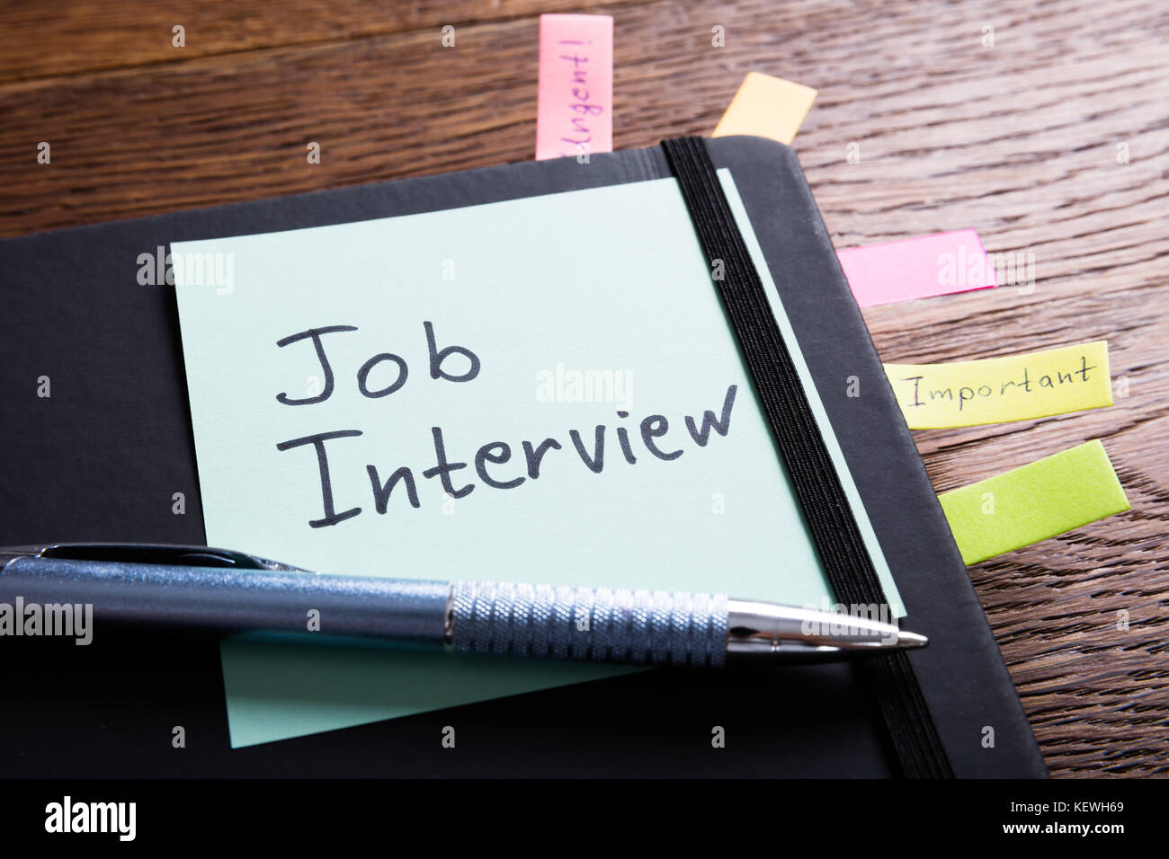 High Angle View Of A Job Interview Concept In Diary With Sticky Note - Stock Image