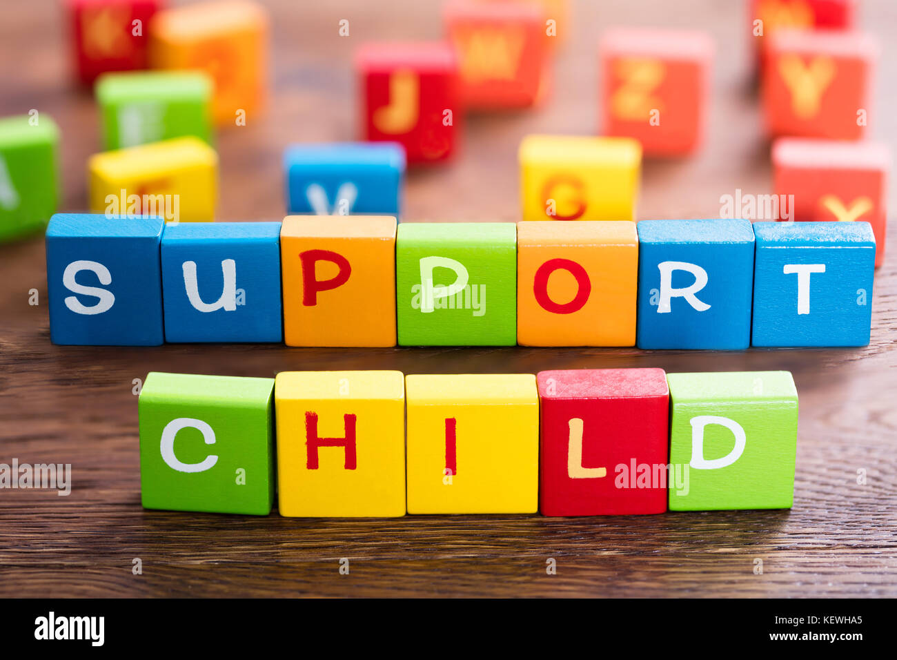 Child Support Concept On Colorful Block At Wooden Desk - Stock Image