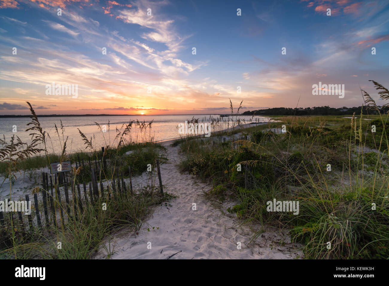 Beautiful sunset through the dunes of the South End of Amelia Island, Florida - Stock Image