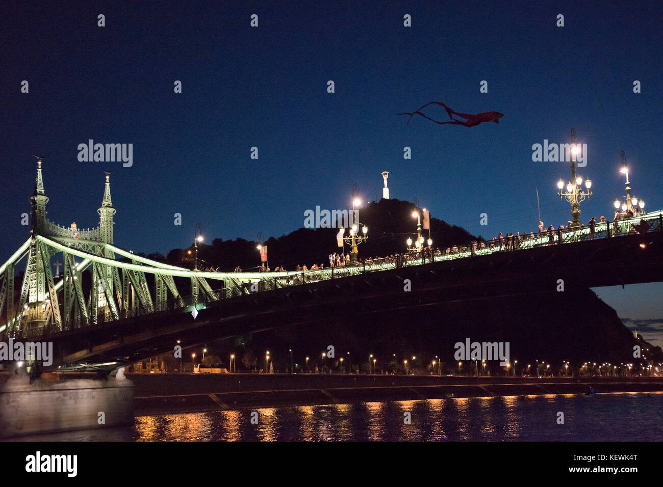 Horizontal view of people partying on the closed Liberty Bridge in Budapest. - Stock Image