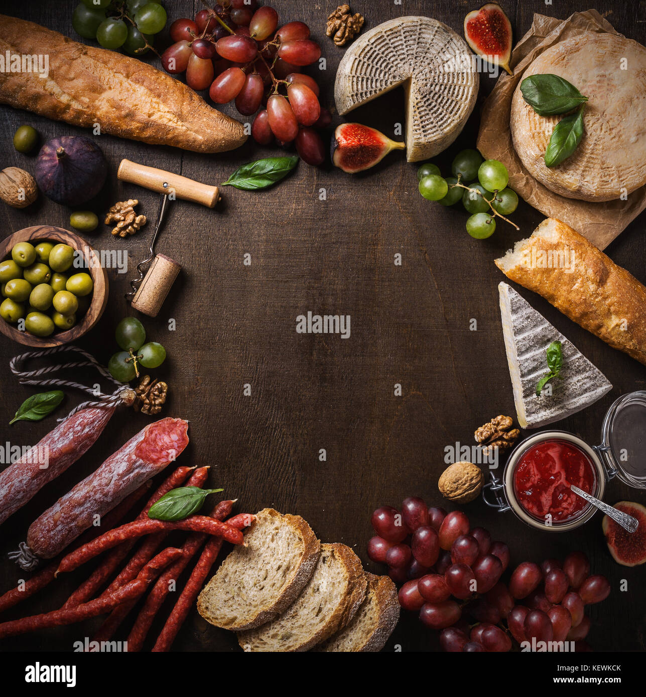 Flat lay composition with cheese, meat and fruits. Top view, copy space - Stock Image