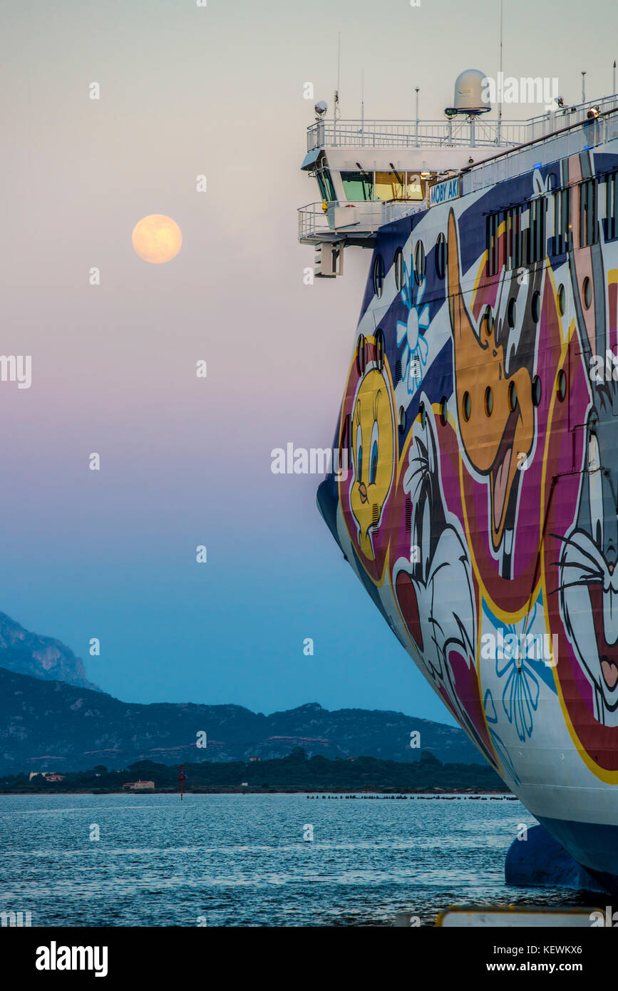 ITALY, SARDINIA,  Bow of the Car ferry Mobi Aki in the harbour of Olbia with full moon - Stock Image