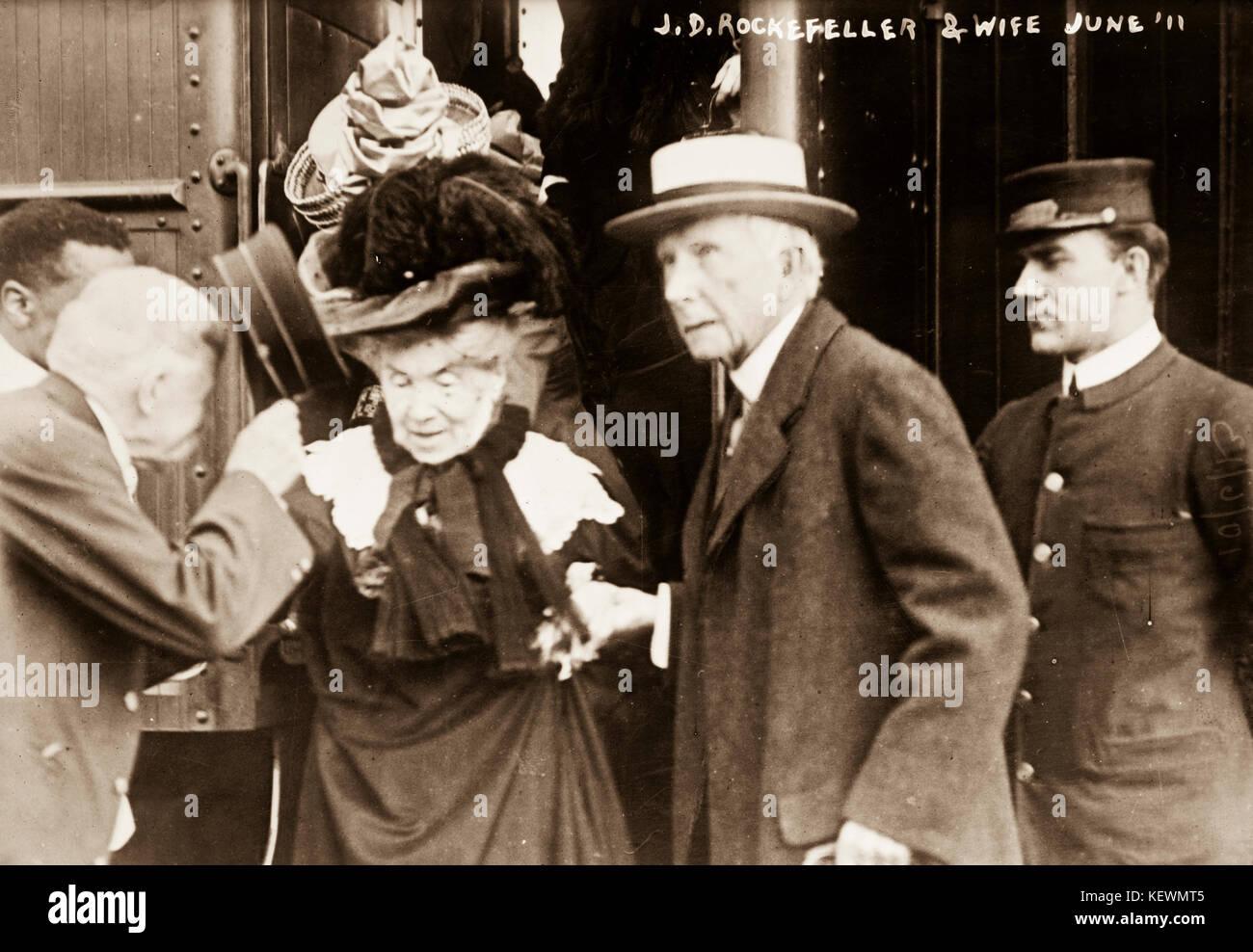 John Davison Rockefeller, 1839-1937, with wife disembarking train - Stock Image