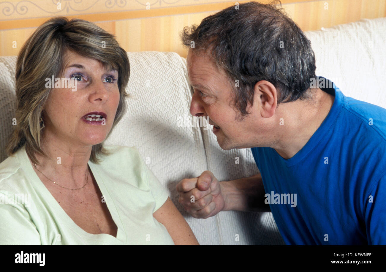 middle aged couple having argument - Stock Image