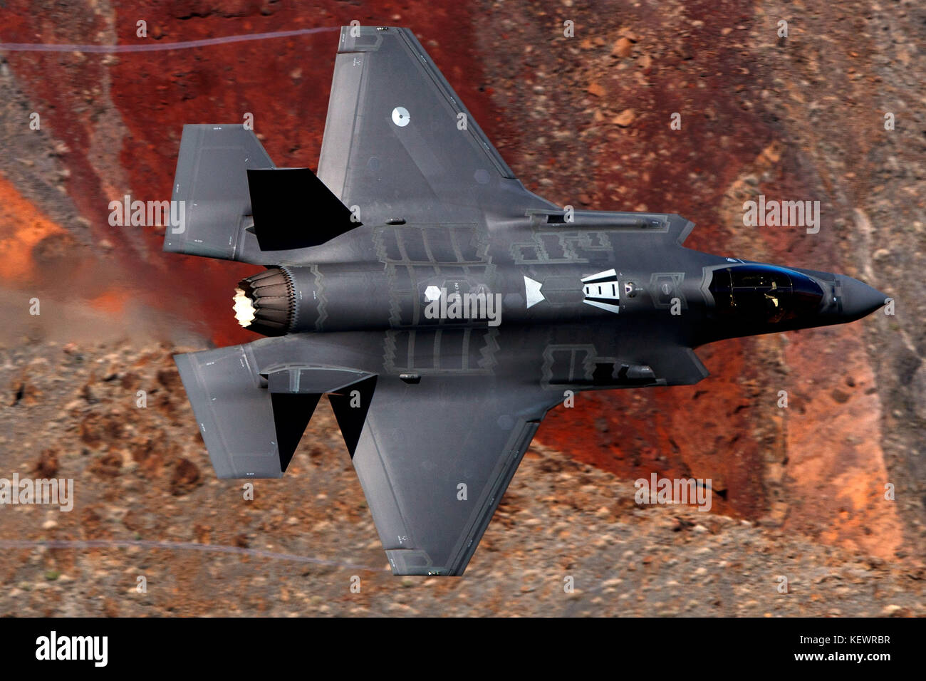 Lockheed Martin F-35A Lighting II (OT-002) from the 323 Squadron, Royal Netherlands Air Force, flies low level through - Stock Image