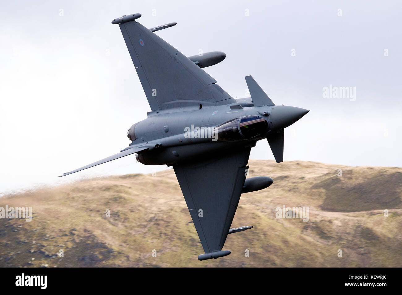 Royal Air Force Eurofighter Typhoon FGR4 (ZK371) flies low level through the Mach Loop, Machynlleth, Wales, United - Stock Image