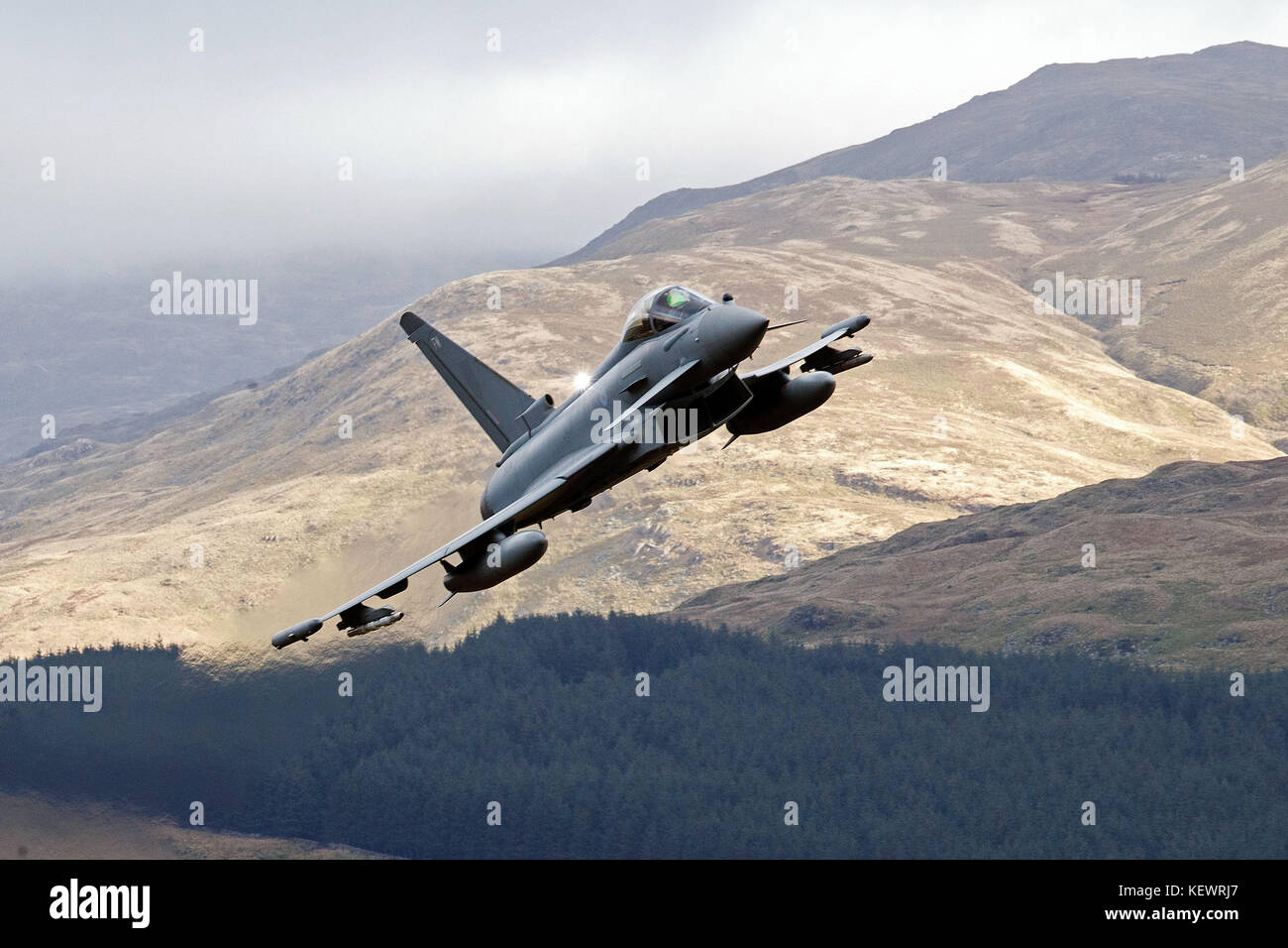 Royal Air Force Eurofighter Typhoon FGR4 (ZK304) flies low level through the Mach Loop, Machynlleth, Wales, United - Stock Image