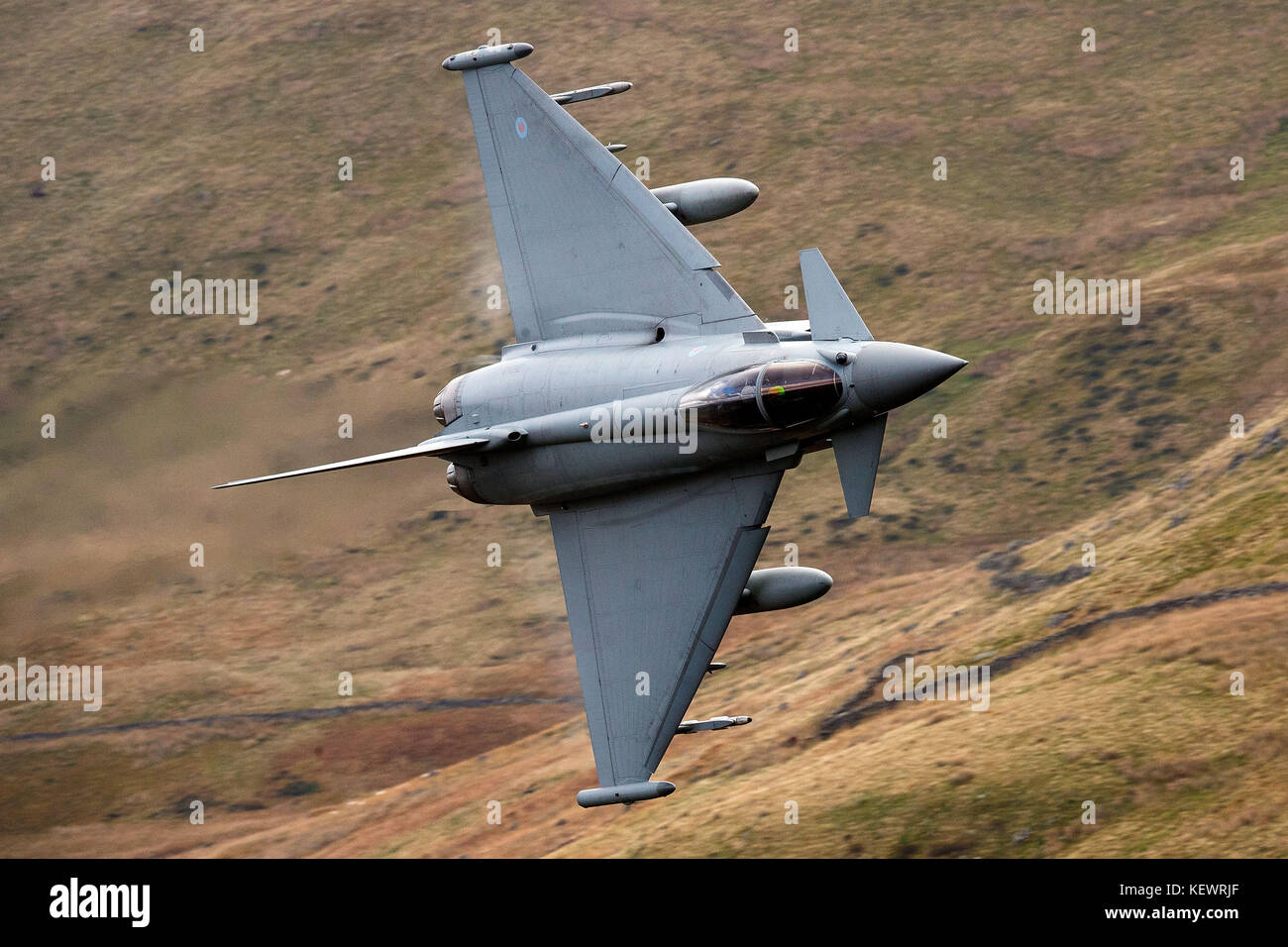 Royal Air Force Eurofighter Typhoon FGR4 (ZK313) flies low level through the Mach Loop, Machynlleth, Wales, United - Stock Image