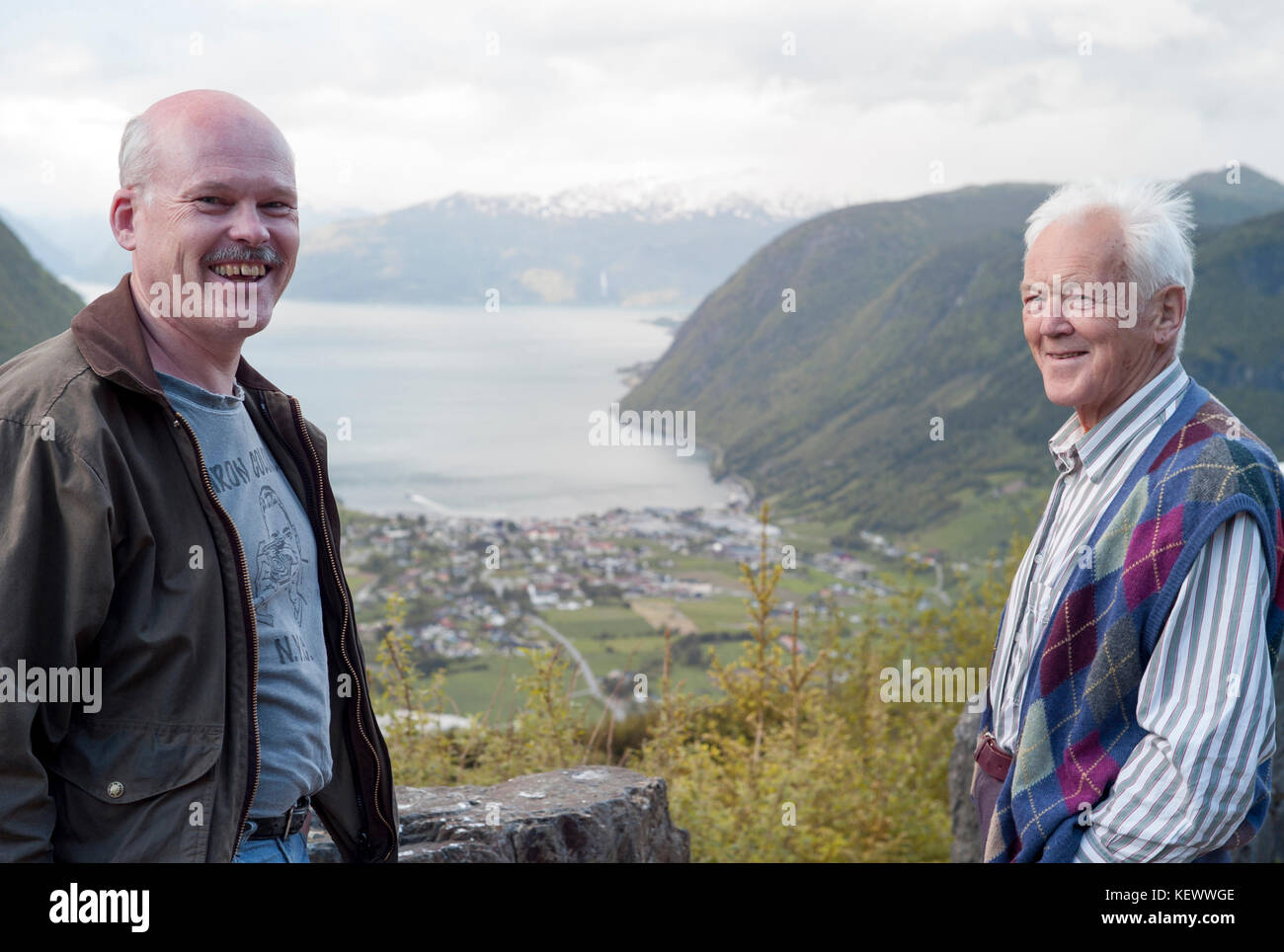 Father and son, happy reunion. This is the community my father build the 'Vik Verk' back in 1968-69, a factory - Stock Image