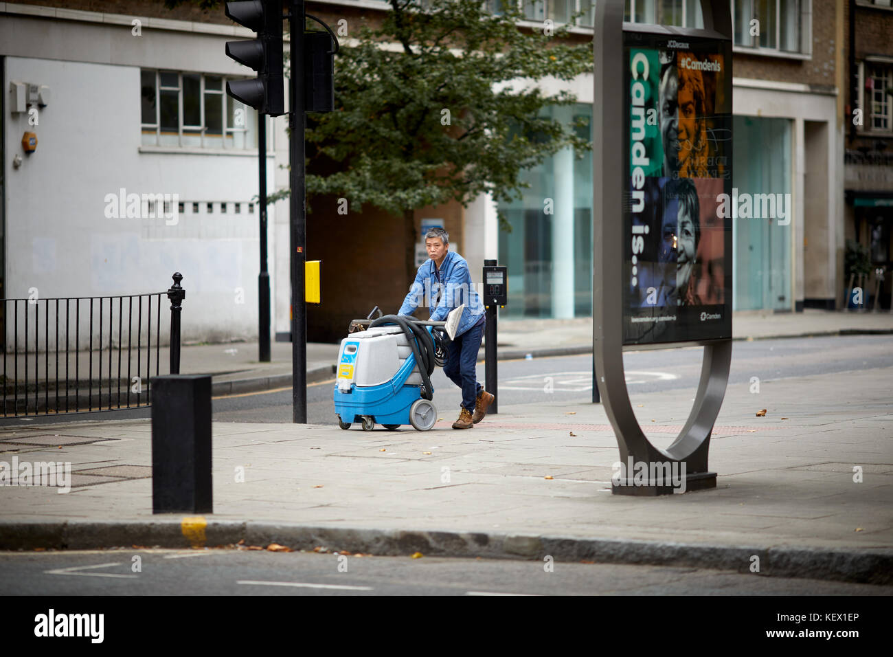 Man walking at cleaning machine in London the capital city of England Stock Photo