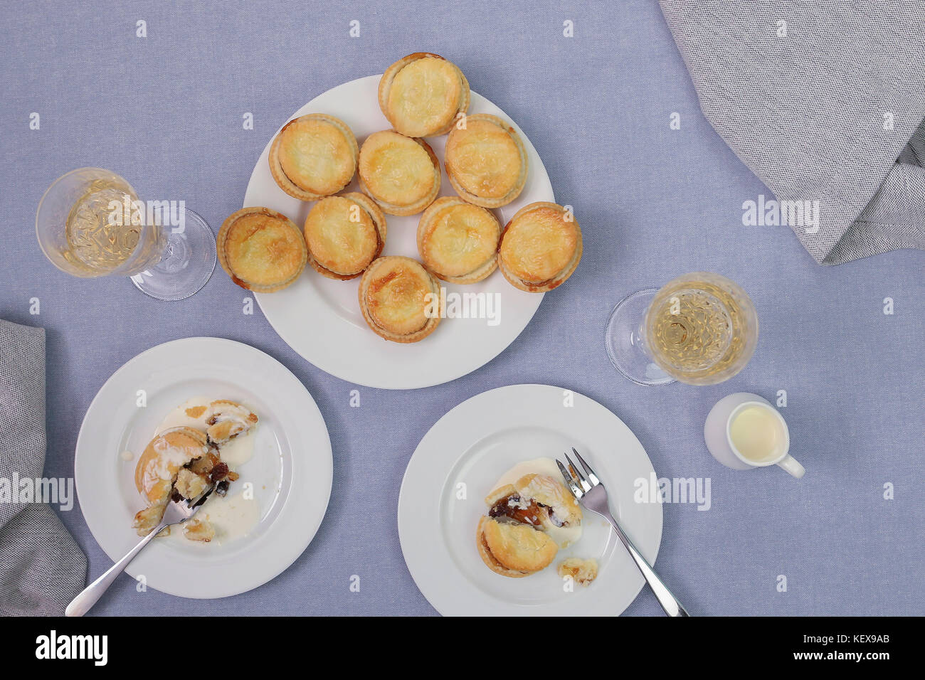 Christmas food, mince pies with champagne. - Stock Image