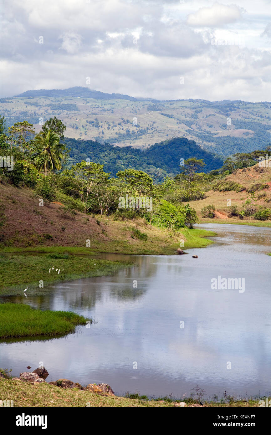 Natural stream, pond, and countryside between San Jose and La Fortuna, Alajuela region, Costa Rica. - Stock Image