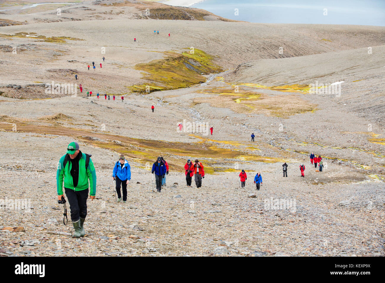 Passengers on an expedition cruise to Anarctica recreat part of Shakleton's famous walk across South Georgia. The Stock Photo