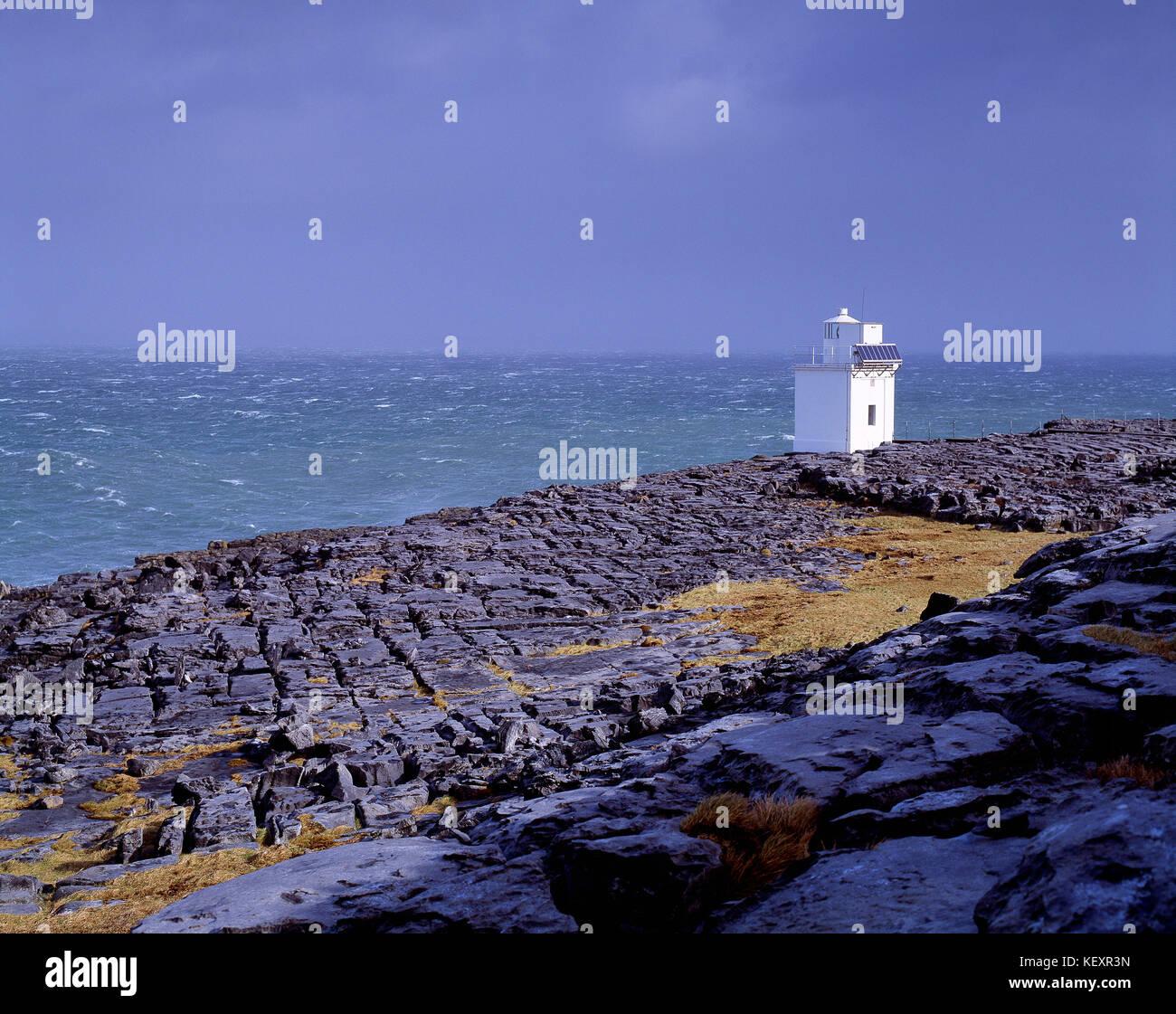 Ireland. County Clare. Coast with Blackhead Lighthouse.The Burren limestone pavement. - Stock Image