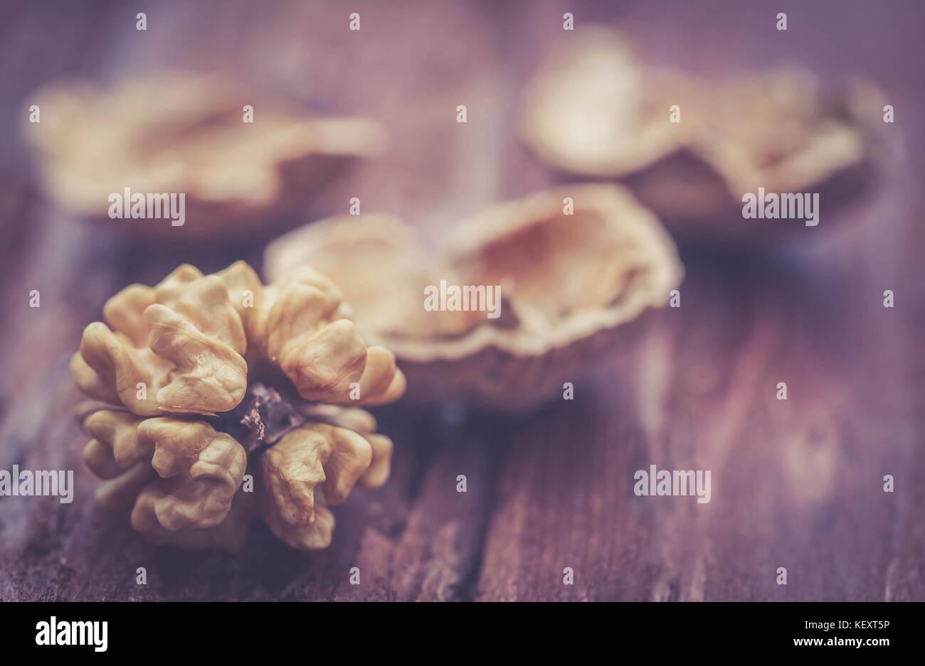 Walnut closeup on natural surface - Stock Image