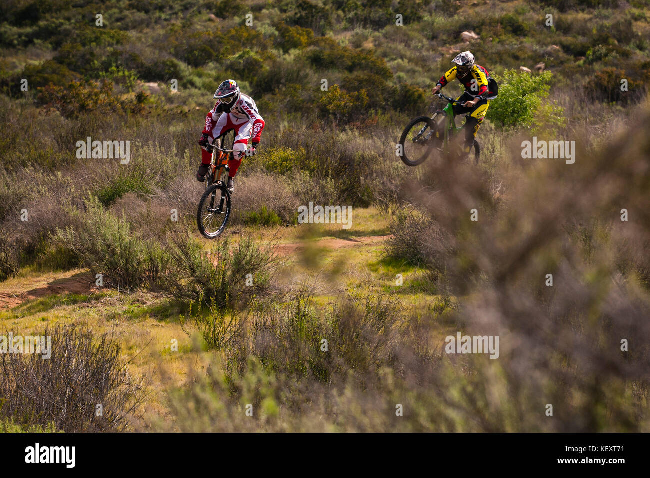 JD Swanguen (Left) and Jacob Hyde ride a trail in San Diego County, CA. Feb 23rd 2011. - Stock Image