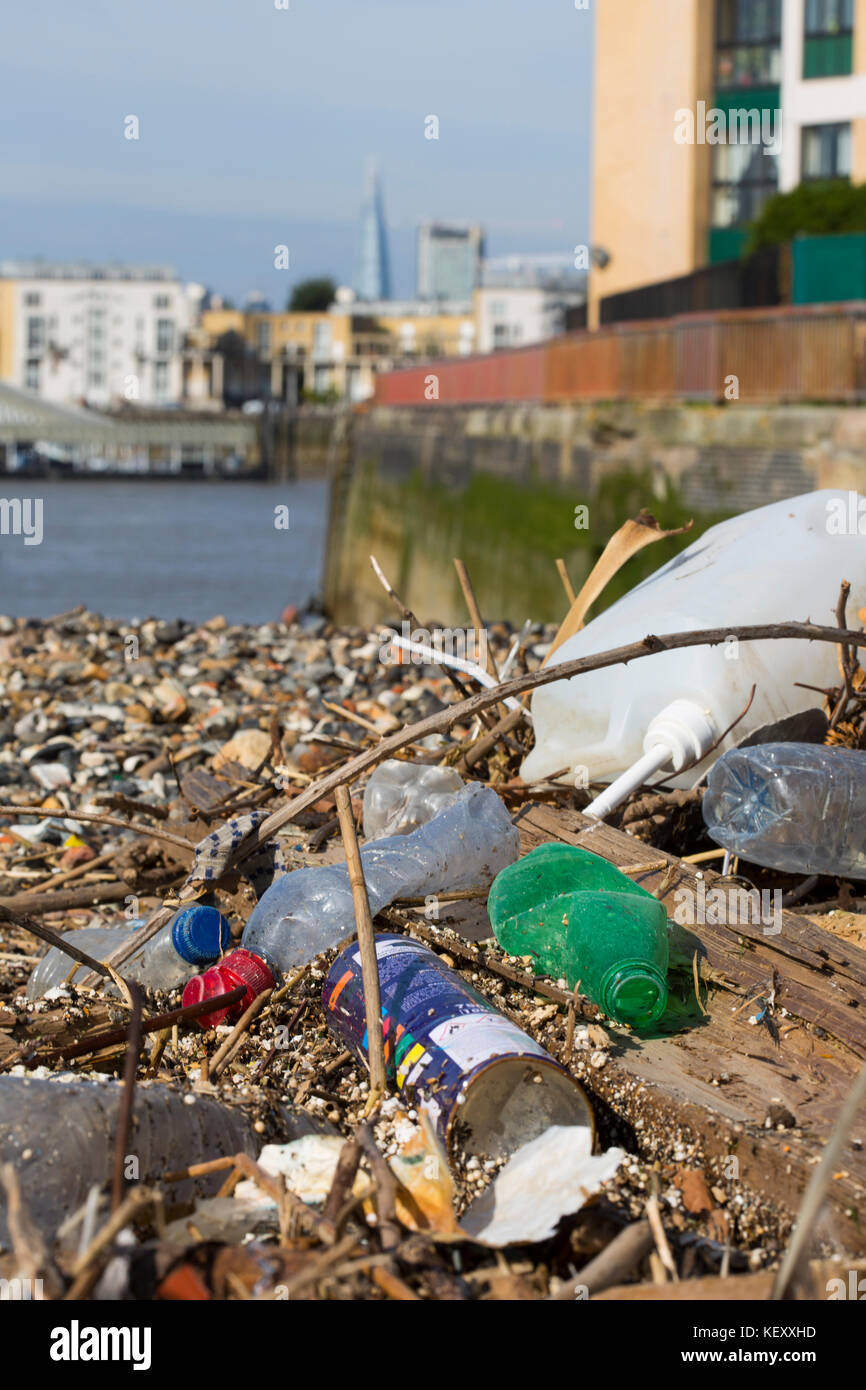 Volunteer clean up of the river Thames in London. Plastic pollution in our rivers and seas is being recognised as - Stock Image