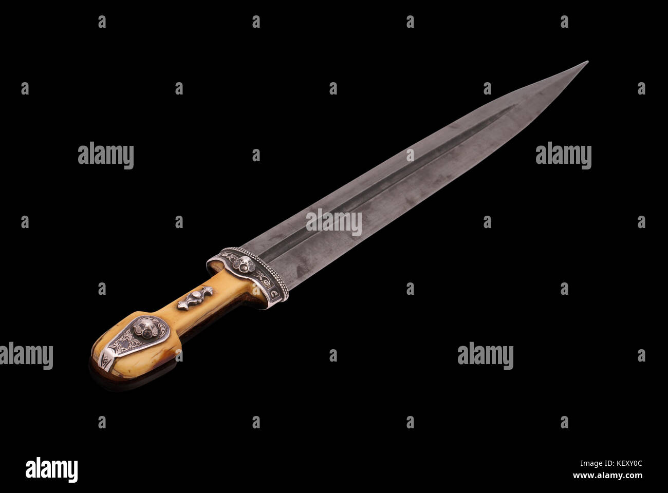 Beautiful example of caucasian dagger with ornament grip and blade from Damascus steel. (1907). Dag(h)estani master Stock Photo