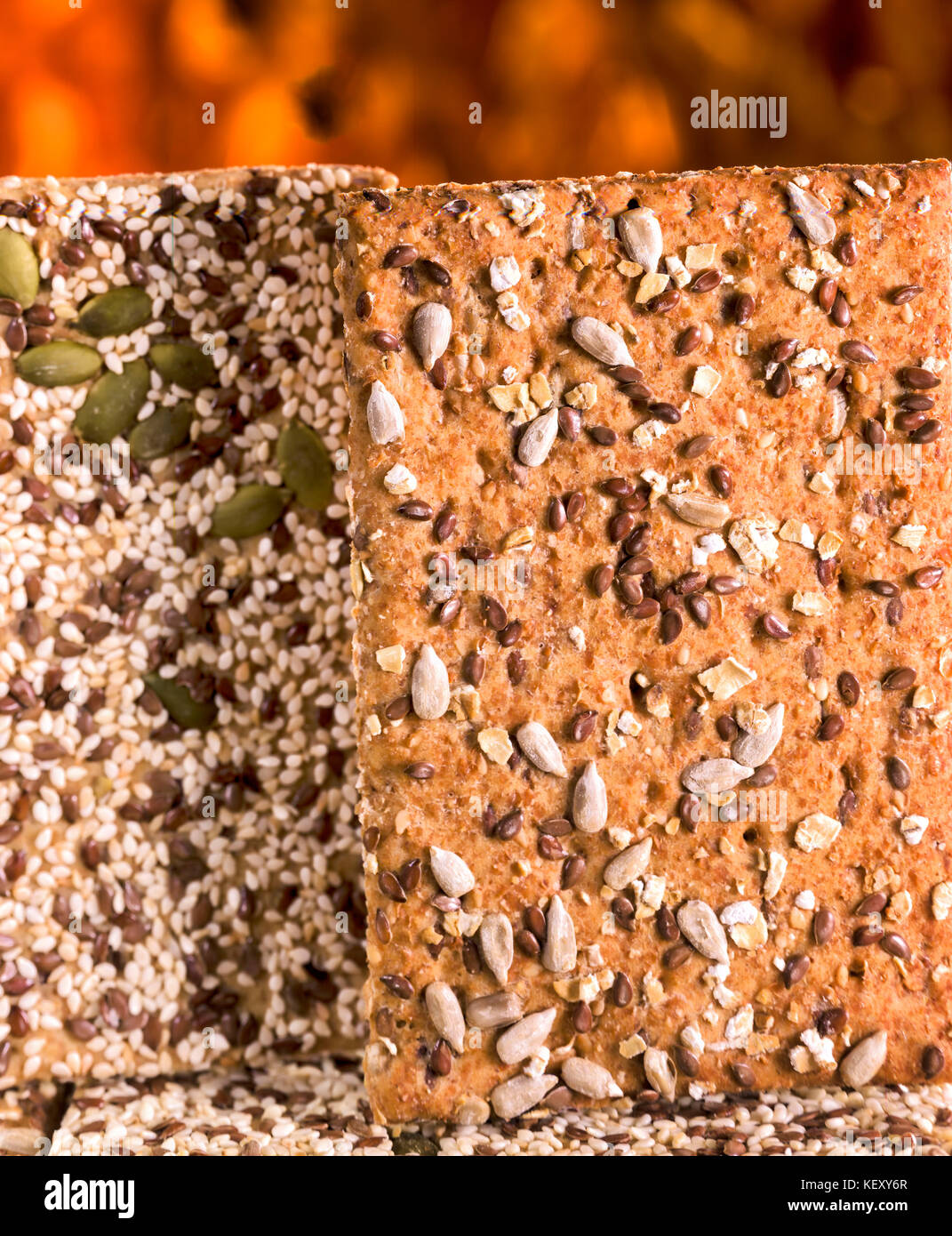 Two heavily seeded crisp breads as a still life photograph - Stock Image