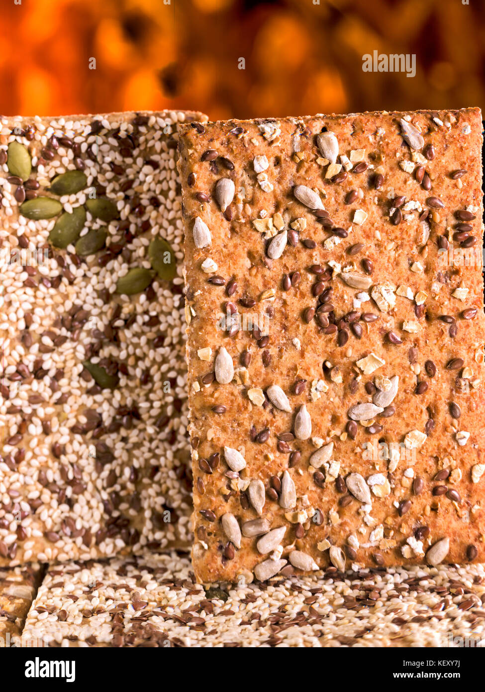 two grain covered crisp breads as a close up macro photographCrisp-bread - Stock Image