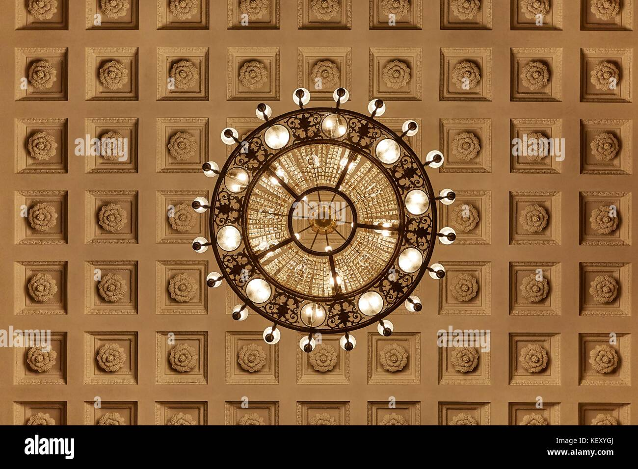 Chandelier on decoarted ceiling Stock Photo