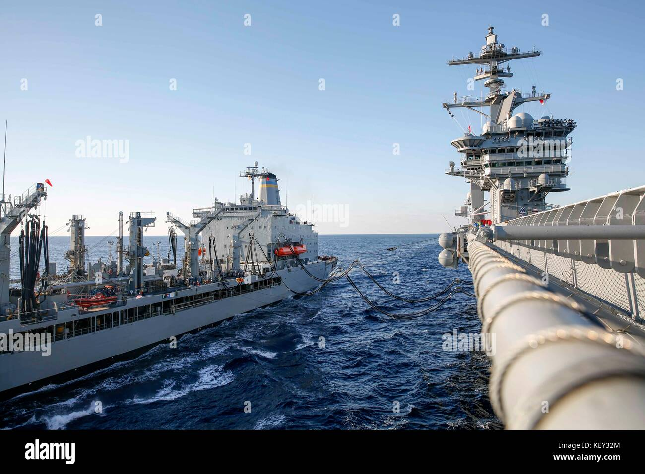 The Nimitz-class aircraft carrier USS Abraham Lincoln (CVN 72) performs an underway replenishment. - Stock Image